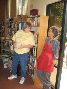 Helen and Nancy working the Flea Market in 2012. We have a much smaller flea market this year.