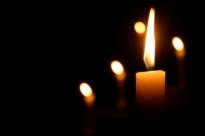 Candles Burning in Dark Church