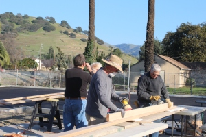 Volunteers prepare wood for the sanctuary.